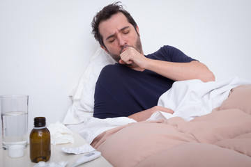 Man feeling bad lying in the bed