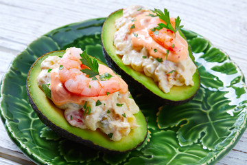 Seafood filled avocado with shrimps tapas pinchos