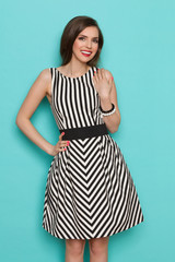 Smiling Young Woman In Black And White Striped Dress
