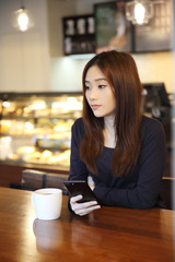 one Asian woman thinking with smart phone