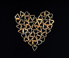Heart shape made of  pasta. Pasta in the shape of a heart on a b
