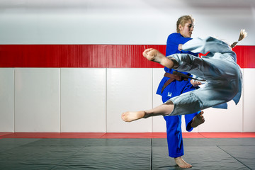 Two women fight judo on tatami