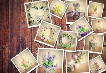 Heap of printed vintage pictures with floral decorations theme on brown wooden background.