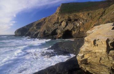Boulder and sea cave Tregardock Beach Cornwall