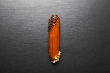 Group of french dessert Eclair on black background