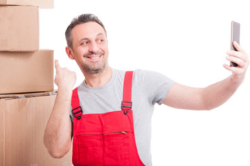 Mover guy pointing box and taking selfie and smiling