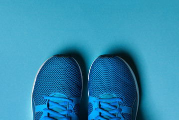 One Pair of blue sport shoes on blue background.