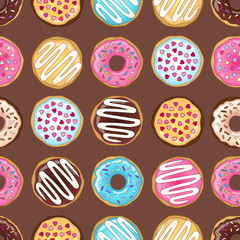 Multicolor donuts seamless pattern on the pink and orange lines background.
