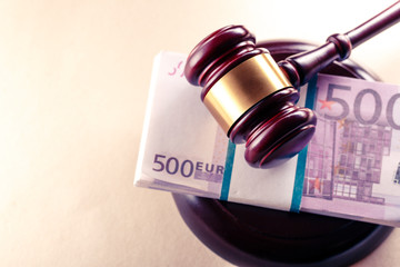 Wooden judge's gavel and euro