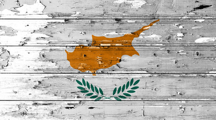 Cyprus flag on wood texture background with old paint peels