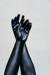Black Hand of death on a gray background, the walking dead
