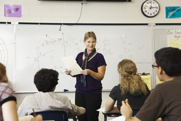 Woman teaching high school mathematics class