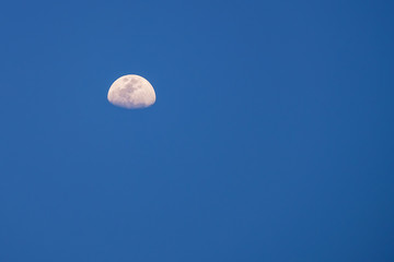 moon at blue sky during afternoon