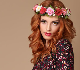Fashion Beautiful Curly Redhead Portrait in Flower Wreath. Shiny Curly flower fashion Volume Hairstyle. Happy Beauty Model Woman. Glamour Confident Sexy lady, fashion Makeup, Boho wreath, Trendy Dress
