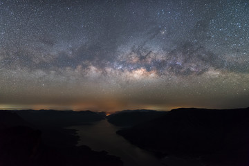 Clearly Milky way above the lake and mountain. Pha Dang Luang view point, Mae Ping National park.