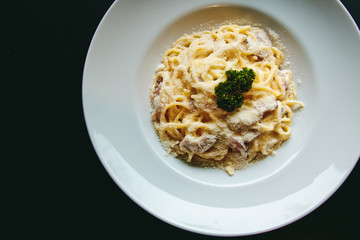 Classic Pasta carbonara Italian with Parmesan Cheese on black background