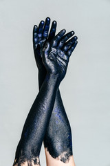 Vertical photo of Black Hand of death with Sparkles on a gray background