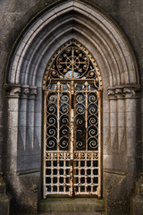 Graveyard tomb door Rusty locked gate archway