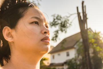 close up face of asian women on sunrise background