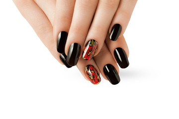 Female hands with red black nails.