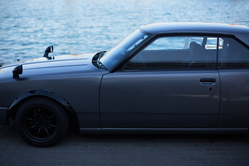 Grey sports coupe. Gray race car. Retro race. Japanese School tuning. Skyline classic japonese car