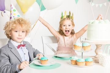 Children sitting at birthday table
