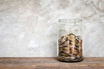 Glass jar with coins.