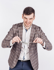 hungry man holding cutlery fork and knife on hand.