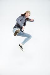 Vertical image of Hipster jumping at camera