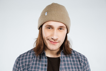Young hipster in shirt and hat