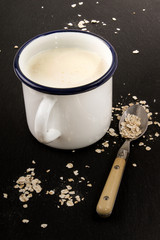 enamel cup with scottish buttermilk and raw oatmeal