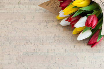 tulips on wooden background with space for text