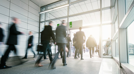 blurred business people in a modern entrance