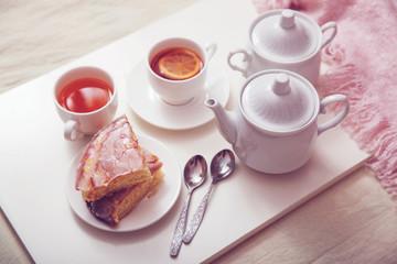 Lemon pie with tea in a white bowl. Breakfast in bed