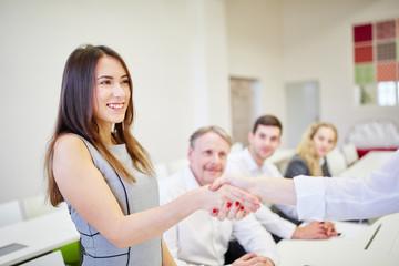 Successful businesswoman shaking hands