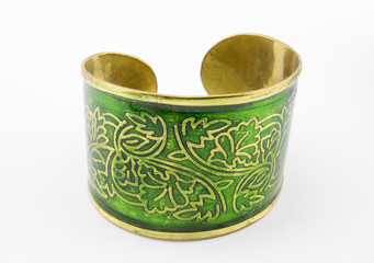 Green and gold bangle on white