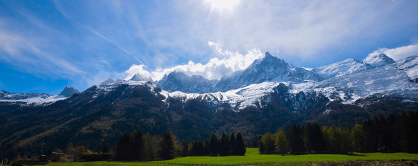 Mont Blanc Mountain covered with snow in spring. Amazing panorama with snow avalanche of French Alps in the spring.