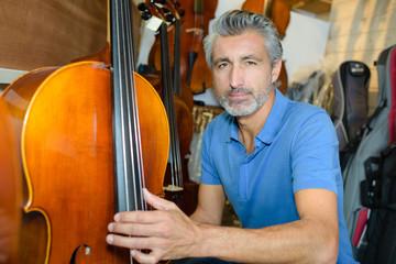 while holding a cello