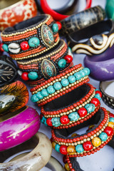 Detail of bracelets and rings at the Tibetan Market in  Wednesday Flea Market in Anjuna, Goa, India.