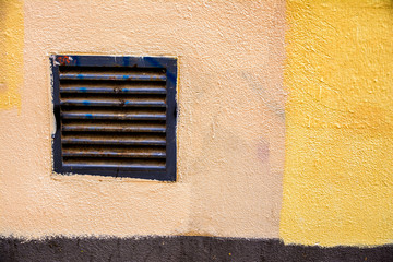 old air duct at colorful wall