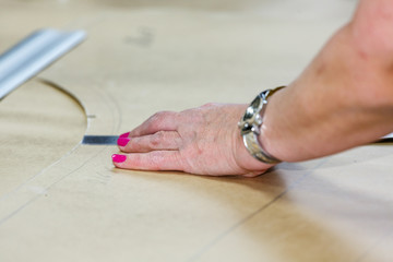 Woman hands working with patterns