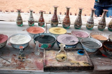 Traditional souvenirs in bottles with sand shows desert and camels, Petra in Jordan