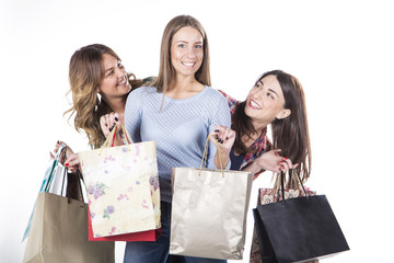 Group of happy women smiling with shopping bags isolated on white background.