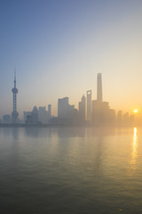 Skyline of Pudong from The Bund on a foggy November morning, Shanghai, China