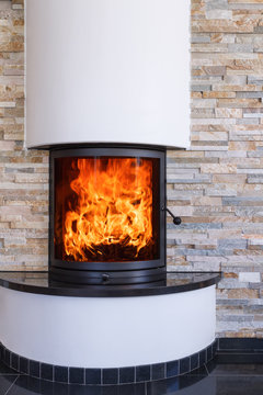 An interior shot of a modern marble fireplace