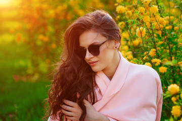 beautiful young girl with glasses is fashionable, stylish , spring mood