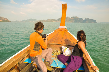 Man and woman floating in a boat among the islands