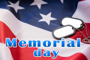 memorial day words over american flag and dog tags
