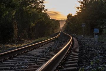 The train runs along the railroad tracks to infinity