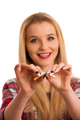 Young woman breaks cigarette as gesture for quit smoking isolated over white